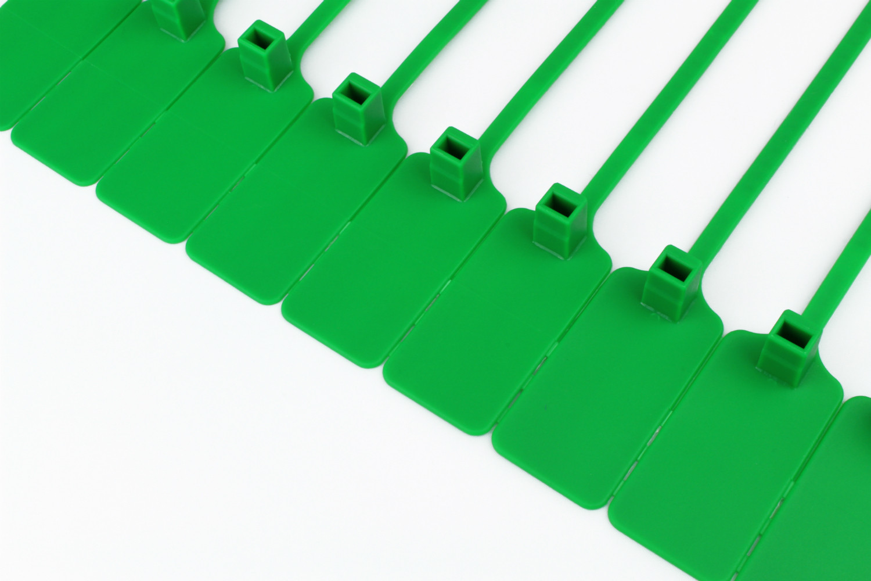 Tracewaste Pull Through Seals - Green 500 pieces