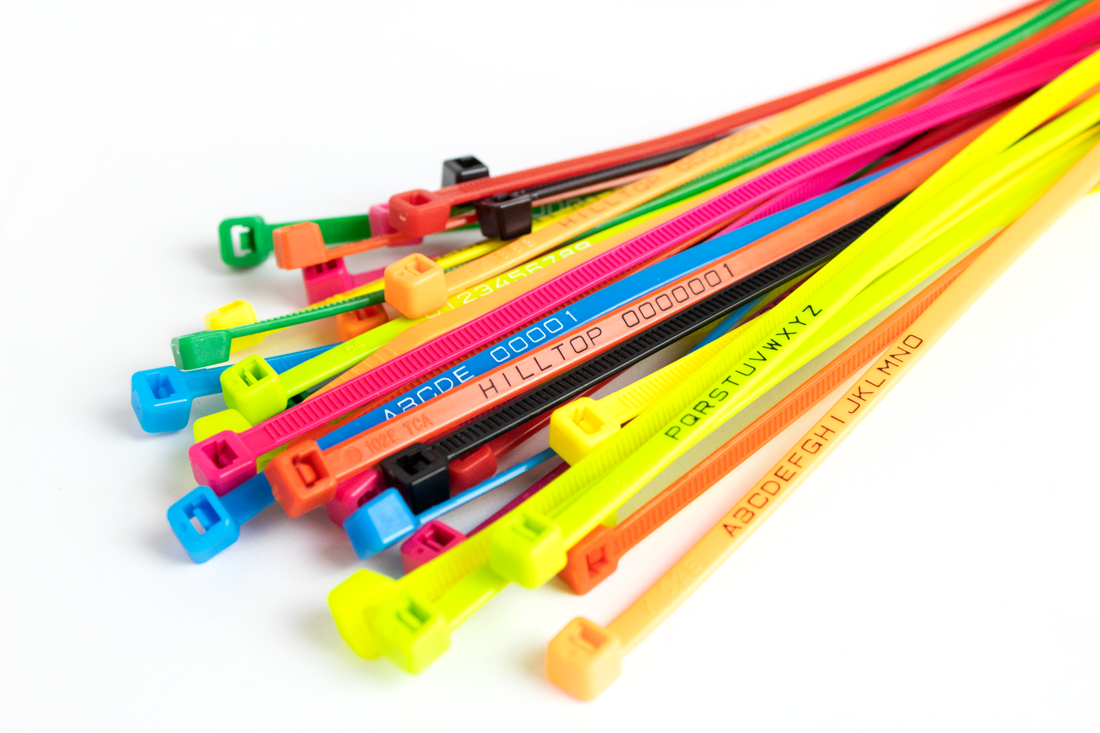 Cable ties in various colours, some with printed letters or numbers